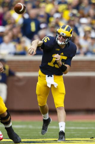 Sep 19, 2015; Ann Arbor, MI, USA; Michigan Wolverines quarterback Jake Rudock (15) passes the ball in the fourth quarter against the UNLV Rebels at Michigan Stadium. Michigan won 28-7. Mandatory C ...