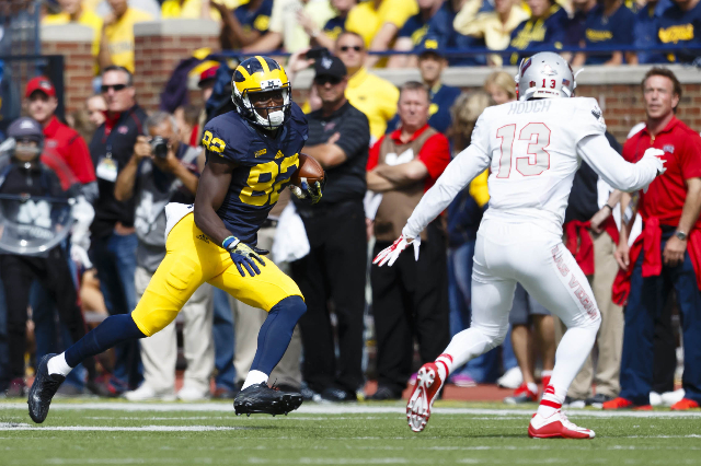 Sep 19, 2015; Ann Arbor, MI, USA; Michigan Wolverines wide receiver Amara Darboh (82) runs the bases at UNLV Rebels defensive back Tim Hough (13) in the fourth quarter at Michigan Stadium. Michiga ...