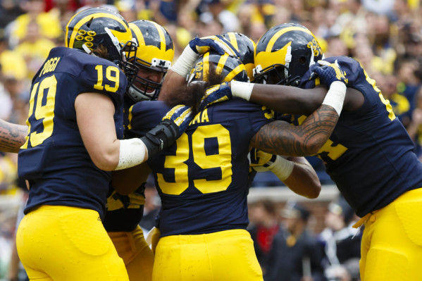 Sep 19, 2015; Ann Arbor, MI, USA; Michigan Wolverines fullback Sione Houma (39) receives congratulations from teammates after scoring a touchdown in the fourth quarter against the UNLV Rebels at M ...