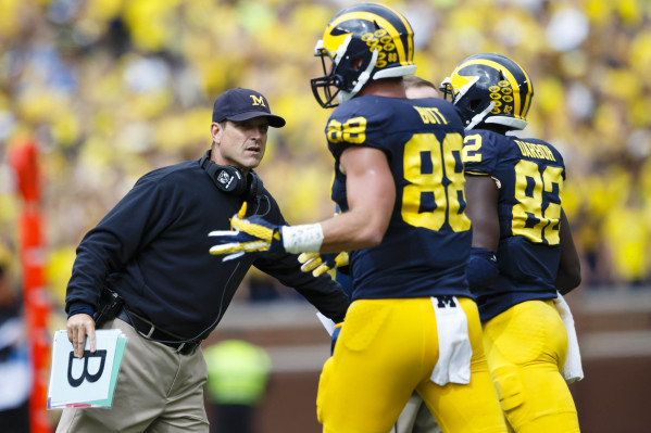 Sep 19, 2015; Ann Arbor, MI, USA; Michigan Wolverines head coach Jim Harbaugh greets players coming off the field in the fourth quarter against the UNLV Rebels at Michigan Stadium. Michigan won 28 ...