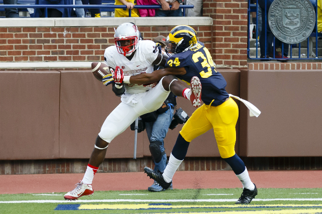 Sep 19, 2015; Ann Arbor, MI, USA; Michigan Wolverines safety Jeremy Clark (34) breaks up a pass to UNLV Rebels wide receiver Kendal Keys (84) in the fourth quarter at Michigan Stadium. Mandatory C ...