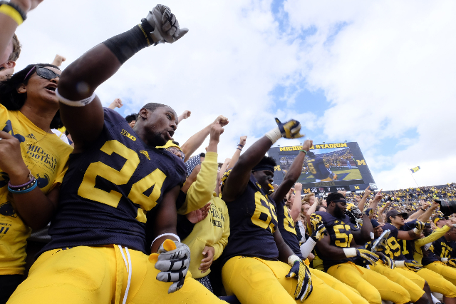 Sep 19, 2015; Ann Arbor, MI, USA; Michigan Wolverines players celebrate in the student section after the game against the UNLV Rebels at Michigan Stadium. Michigan won 28-7. Mandatory Credit: Rick ...