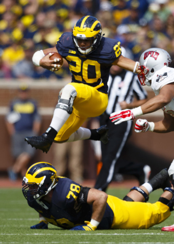 Sep 19, 2015; Ann Arbor, MI, USA; Michigan Wolverines running back Drake Johnson (20) rushes in the fourth quarter against the UNLV Rebels at Michigan Stadium. The play was called back for a penal ...