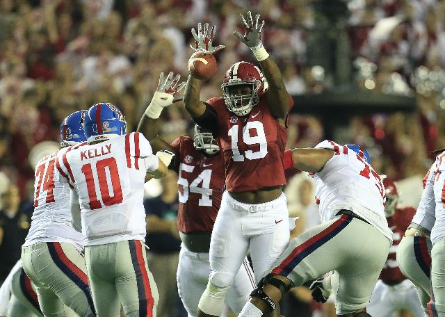 Sep 19, 2015; Tuscaloosa, AL, USA; Alabama Crimson Tide linebacker Reggie Ragland (19) blocks the pass of Mississippi Rebels quarterback Chad Kelly (10)at Bryant-Denny Stadium. Mandatory Credit: M ...