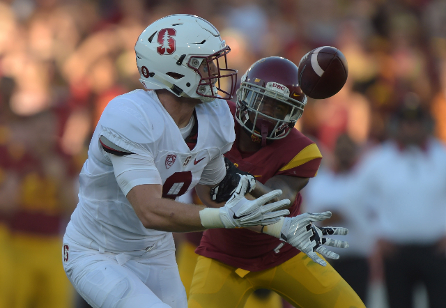Sep 19, 2015; Los Angeles, CA, USA; Stanford Cardinal tight end Dalton Schultz (9) is defended by Southern California Trojans cornerback Marveil Tell III (7) at Los Angeles Memorial Coliseum. Mand ...