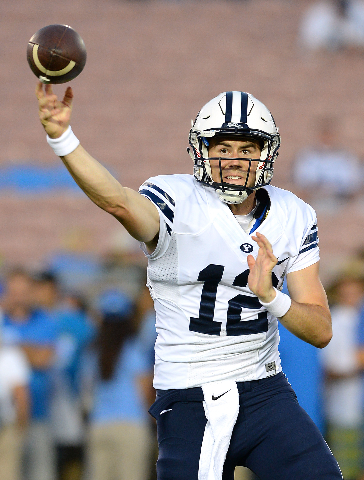 Sep 19, 2015; Pasadena, CA, USA; Brigham Young Cougars quarterback Tanner Mangum (12) warms up before the game against the UCLA Bruins at the Rose Bowl. (Jayne Kamin-Oncea/USA Today Sports)