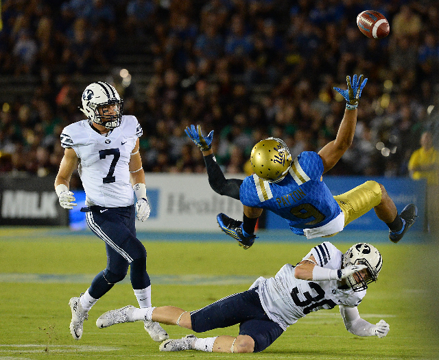 Sep 19, 2015; Pasadena, CA, USA; Brigham Young Cougars defensive back Michael Wadsworth (30) breaks up a pass for UCLA Bruins wide receiver Jordan Payton (9) in the first quarter of the game at Ro ...