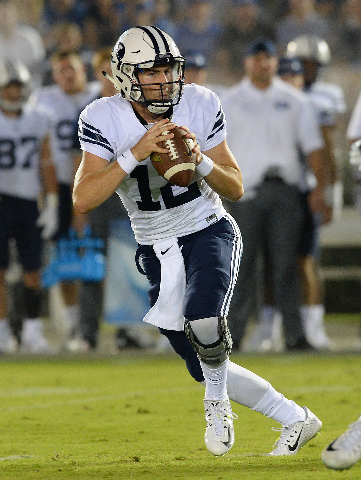 Sep 19, 2015; Pasadena, CA, USA; Brigham Young Cougars quarterback Tanner Mangum (12) looks to pass in the first quarter of the game  against the UCLA Bruins at the Rose Bowl. (Jayne Kamin-Oncea/U ...