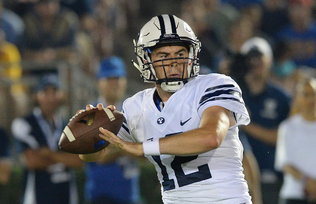 Sep 19, 2015; Pasadena, CA, USA; Brigham Young Cougars quarterback Tanner Mangum (12) sets to pass in the first quarter of the game against the UCLA Bruins at the Rose Bowl. (Jayne Kamin-Oncea/USA ...