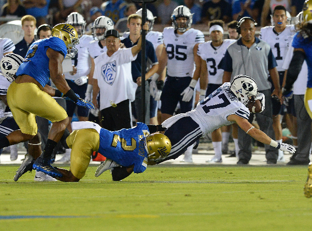 Sep 19, 2015; Pasadena, CA, USA; UCLA Bruins defensive back Jaleel Wadood (2) tackles Brigham Young Cougars defensive back Grant Jones (37) after a 6 yard gain in the first quarter of the game aga ...