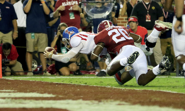 Sep 19, 2015; Tuscaloosa, AL, USA; Mississippi Rebels quarterback Chad Kelly (10) dives over the goal as he is hit by Alabama Crimson Tide linebacker Shaun Hamilton (20) at Bryant-Denny Stadium. M ...