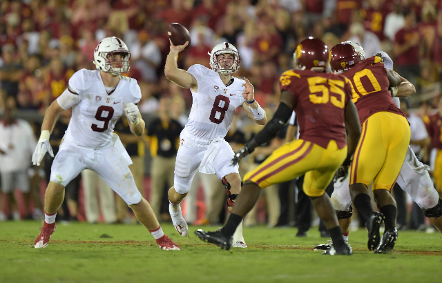 Sep 19, 2015; Los Angeles, CA, USA; Stanford Cardinal quarterback Kevin Hogan (8) throws a pass against the Southern California Trojans at Los Angeles Memorial Coliseum. Mandatory Credit: Kirby Le ...