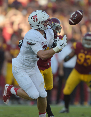 Sep 19, 2015; Los Angeles, CA, USA; Stanford Cardinal tight end Dalton Schultz (9) is defended on a pass play by Southern California Trojans cornerback Marveil Tell III (7) at Los Angeles Memorial ...