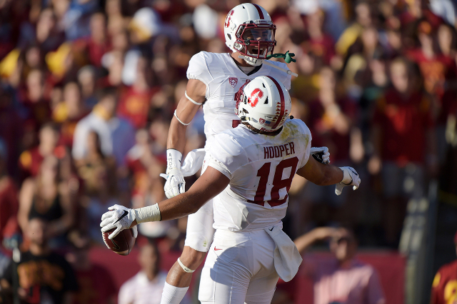 Sep 19, 2015; Los Angeles, CA, USA; Stanford Cardinal tight end Austin Hooper (18) celebrates with receiver Michael Rector (3) after scoring on a 16-yard touchdown reception in the first quarter a ...