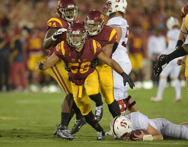 Sep 19, 2015; Los Angeles, CA, USA; Southern California Trojans linebacker Anthony Sarao (56) celebrates after  a tackle against the Stanford Cardinal at Los Angeles Memorial Coliseum. Stanford de ...