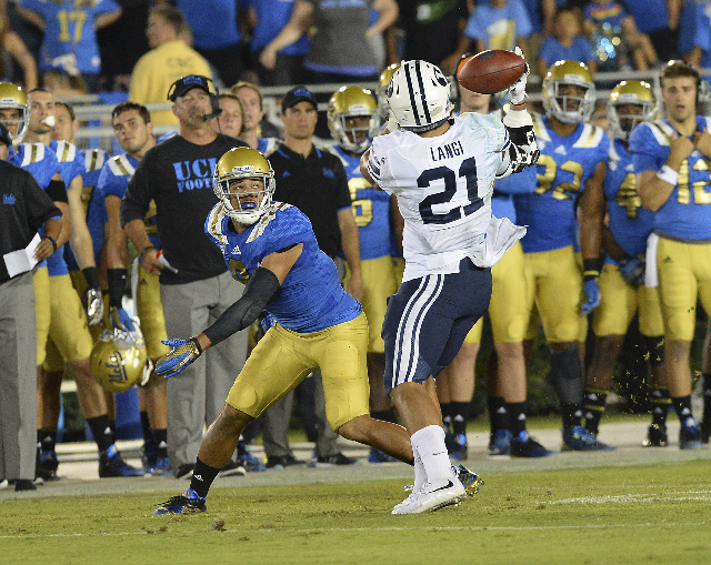 Sep 19, 2015; Pasadena, CA, USA; Brigham Young Cougars linebacker Harvey Langi (21) intercepts a pass intended for UCLA Bruins wide receiver Jordan Payton (9) in the second quarter of the game at  ...