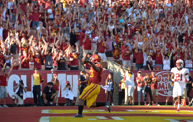 Sep 19, 2015; Los Angeles, CA, USA; Southern California Trojans tailback Tre Madden (23) scores on a 5-yard touchdown run in the first quarter against the Stanford Cardinal at Los Angeles Memorial ...