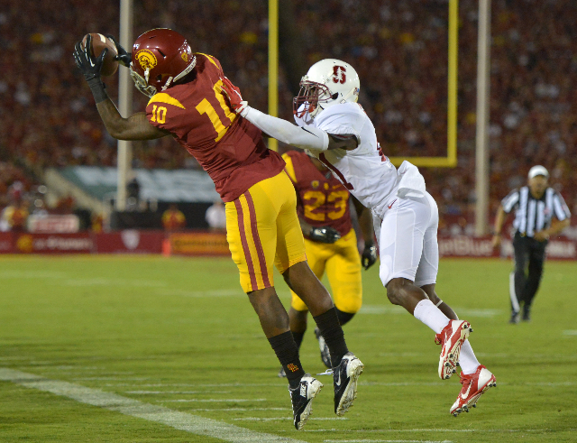 Sep 19, 2015; Los Angeles, CA, USA; Southern California Trojans receiver JuJu Smith-Schuster (9) is defended by  Stanford Cardinal cornerback Ronnie Harris (21) in the fourth quarter at Los Angele ...