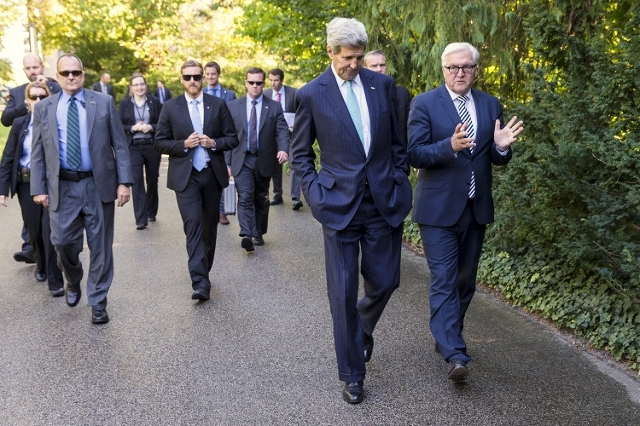 U.S. Secretary of State John Kerry (2nd R) walks with German Foreign Minister Frank-Walter Steinmeier (R) prior to a meeting with a group of refugees fleeing Syria at Villa Borsig in Berlin, Germa ...