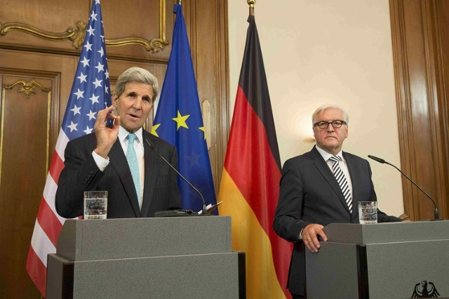 German Foreign Minister Frank-Walter Steinmeier (R) and U.S. Secretary of State John Kerry address the media after their meeting at German foreign ministry's guesthouse Villa Borsig at lake  ...