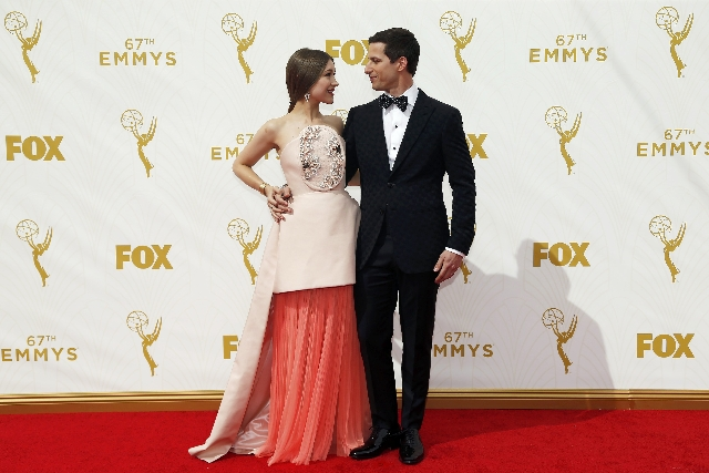 Show host Andy Samberg and his wife Joanna Newsom arrive at the 67th Primetime Emmy Awards in Los Angeles, California September 20, 2015. (Mario Anzuoni/Reuters)