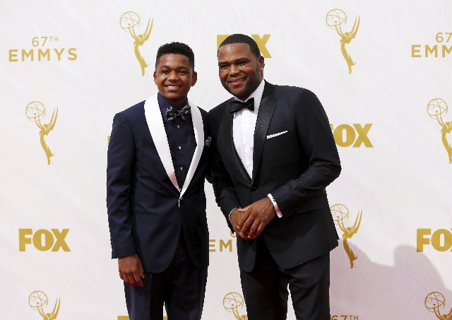 """Actor Anthony Anderson (R), from the TV comedy series """"Blackish"""", and his son Nathan arrive at the 67th Primetime Emmy Awards in Los Angeles, California September 20, 2015. (Mario Anzuon ..."""