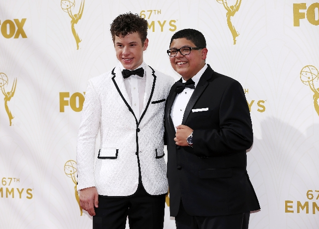 Actors Nolan Gould (L) and Rico Rodriguez arrive at the 67th Primetime Emmy Awards in Los Angeles, California September 20, 2015. (Mario Anzuoni/Reuters)