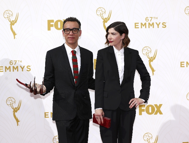 Actors Fred Armisen and Carrie Brownstein arrive at the 67th Primetime Emmy Awards in Los Angeles, California September 20, 2015. (Mario Anzuoni/Reuters)