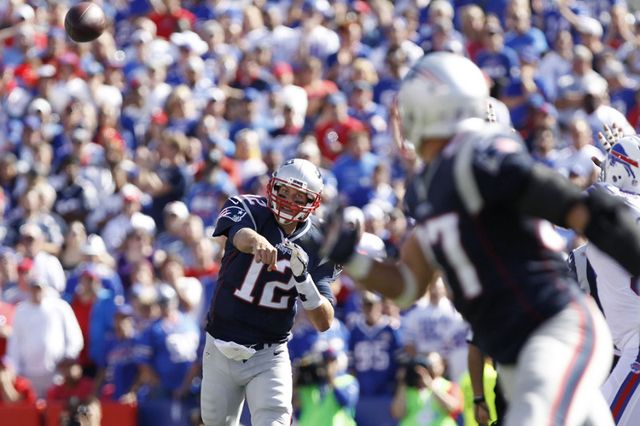 Sep 20, 2015; Orchard Park, NY, USA; New England Patriots quarterback Tom Brady (12) throws a pass tp tight end Rob Gronkowski (87) during the second against the Buffalo Bills half at Ralph Wilson ...