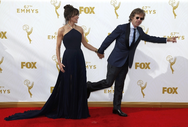 Actors Felicity Huffman and William H. Macy arrive at the 67th Primetime Emmy Awards in Los Angeles, California September 20, 2015.  REUTERS/Mario Anzuoni