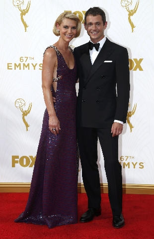 Actors Claire Danes and Hugh Dancy arrive at the 67th Primetime Emmy Awards in Los Angeles, California September 20, 2015.  REUTERS/Mario Anzuoni