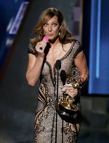 """Allison Janney wipes her face as she accepts the award for Outstanding Supporting Actress In A Comedy Series for her role in """"Mom"""" at the 67th Primetime Emmy Awards in Los Angeles, Calif ..."""