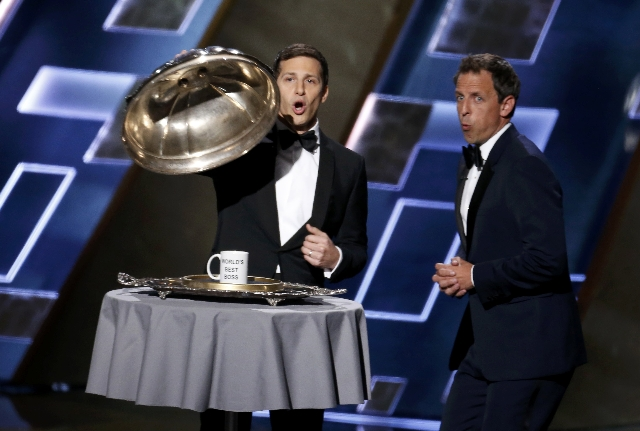 """Host Andy Samberg (L) and guest Seth Meyer, both Saturday Night Live alumni, show off the """"World's Best Boss"""" award in honor of SNL's (Saturday Night Live) producer Lorne Mic ..."""