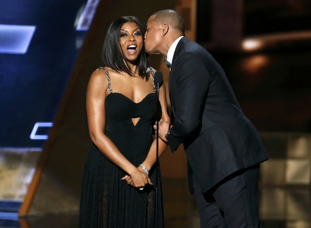 Presenter Terrence Howard kisses Taraji P. Henson om stage at the 67th Primetime Emmy Awards in Los Angeles, California September 20, 2015.  REUTERS/Lucy Nicholson