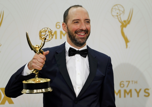 """Actor Tony Hale holds the award for Outstanding Supporting Actor In A Comedy Series for the HBO series """"Veep"""" backstage during the 67th Primetime Emmy Awards in Los Angeles, California S ..."""