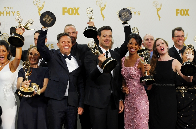 """Producers and crew of NBC's """"The Voice,"""" including executive producer Mark Burnett and host Carson Daly hold their awards for Outstanding Reality-Competition Program backstage duri ..."""