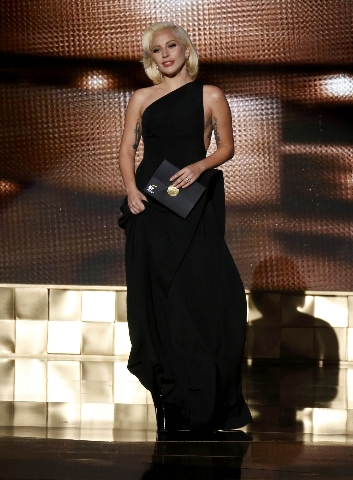 Lady Gaga takes the stage to present the award for Outstanding Lead Actor In A Limited Series Or A Movie at the 67th Primetime Emmy Awards in Los Angeles, California September 20, 2015.  REUTERS/L ...
