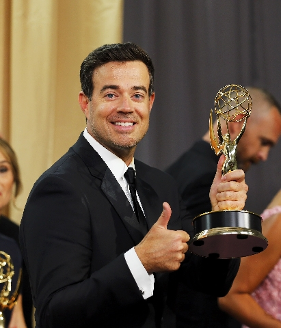 """Host Carson Daly holds the award for Outstanding Reality-Competition Program for NBC's """"The Voice"""" backstage during the 67th Primetime Emmy Awards in Los Angeles, California Septem ..."""