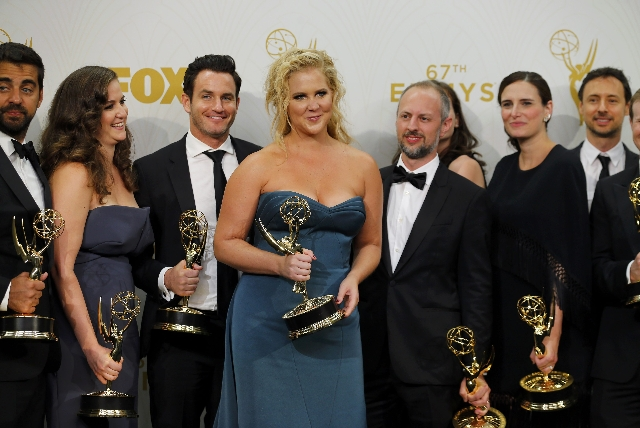 """Comedian Amy Schumer and the crew of Comedy Central's """"Inside Amy Schumer"""" pose backstage with their award for Oustanding Variety Sketch Series during the 67th Primetime Emmy Award ..."""