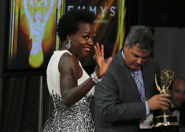 """Actress Viola Davis waves as she walks off after posing with her award for Outstanding Lead Actress In A Drama Series for her role in ABC's """"How To Get Away With Murder"""" backstage  ..."""