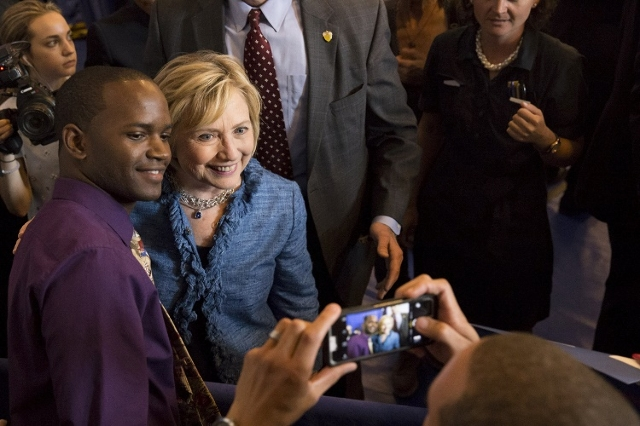 U.S. Democratic presidential candidate Hillary Clinton poses for a photo with a supporter after speaking to a grassroots organizing meeting at the Louisiana Leadership Institute in Baton Rouge, Lo ...
