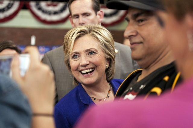 U.S. Democratic presidential candidate Hillary Clinton poses for pictures with the audience following a speech in the gymnasium of Moulton Elementary School in Des Moines, Iowa, September 22, 2015 ...