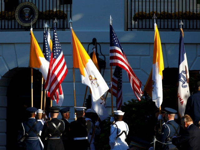 Military honor guards line up with U.S. and Vatican flags before the arrival of Pope Francis at the White House in Washington September 23, 2015. REUTERS/Tony Gentile