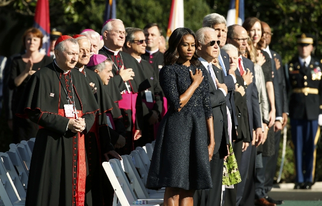 U.S. first lady Michelle Obama stands with U.S. bishops and members of the President Barack Obama's cabinet during an arrival ceremony for Pope Francis at the White House in Washington Septe ...