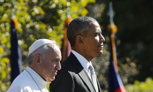 U.S. President Barack Obama (R) stands with Pope Francis during an arrival ceremony for the pope at the White House in Washington September 23, 2015. The pontiff is on his first visit to the Unite ...