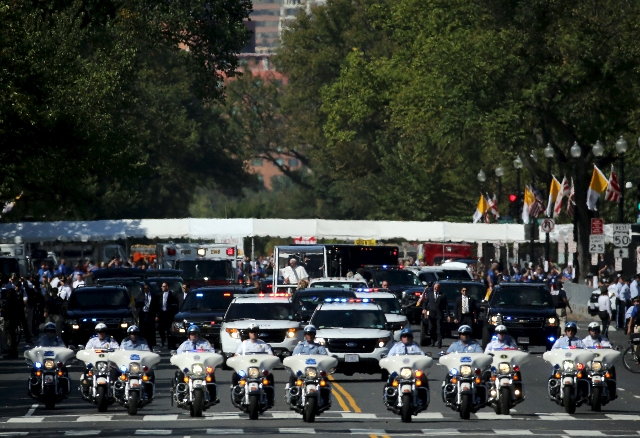 Pope Francis rides down Constitution Avenue in his Popemobile in Washington on day two of his first visit to the United States in Washington September 23, 2015. Pope Francis met with U.S. Presiden ...
