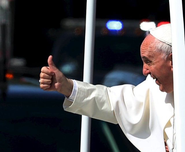 Pope Francis gives a thumbs up to the crowd as he rides down Constitution Avenue in his Popemobile in Washington on day two of his first visit to the United States in Washington September 23, 2015 ...