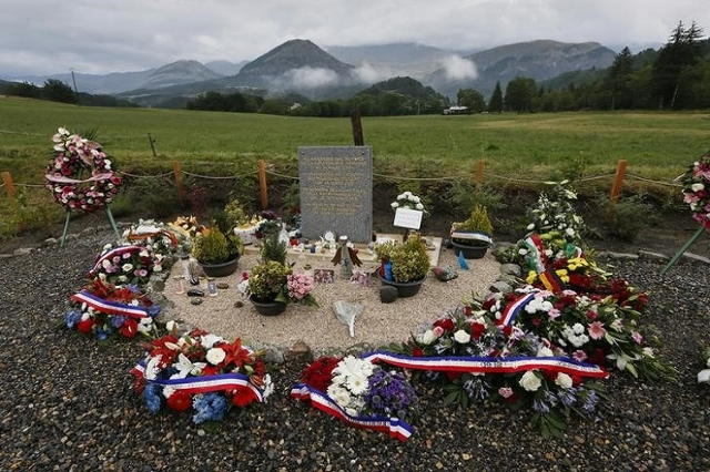 Wreaths of flowers are seen near the stele after families gathered for a ceremony in memory of the victims of the Germanwings Airbus A320 crash in Le Vernet, France, July 24, 2015. (Reuters/Robert ...