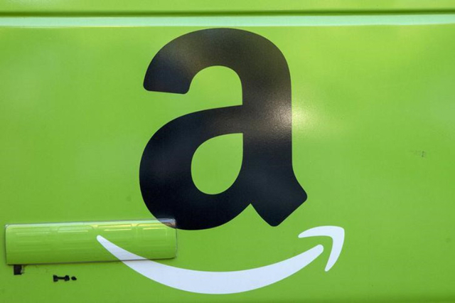 The Amazon.com Inc. logo is seen on the side of a delivery truck in Brooklyn, New York, August 28, 2015. (Brendan McDermid/Reuters)