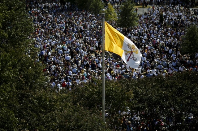 A Vatican flag is seen as people attend the Canonization Mass for Friar Junipero Serra by Pope Francis at the Basilica of the National Shrine of the Immaculate Conception in Washington September 2 ...